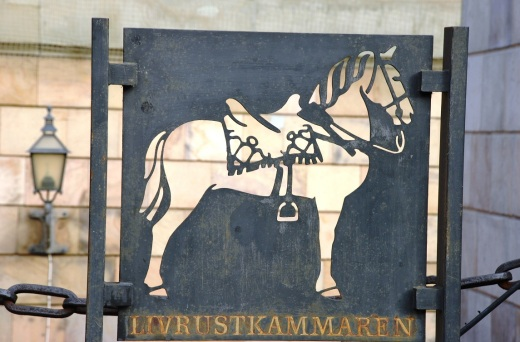 The sign to the Livrustkammaren, the Royal Armoury museum and oldest museum in Sweden.  Gustav II's stuffed stallion from 1632 is in the museum
