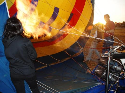 Heating the air in the balloon.