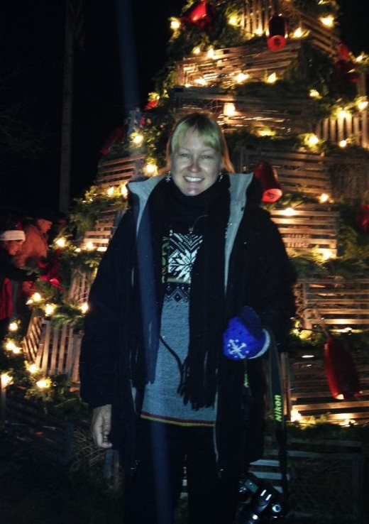 Me in front of the lobster trap Christmas tree.