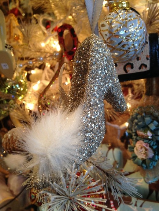 An ornament on the Christmas tree decorated with tiny shoes at Dannah's.