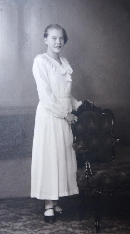My aunt at her confirmation, aged 14