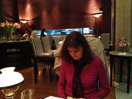 My sister looks over the menu at 1884 Restaurante