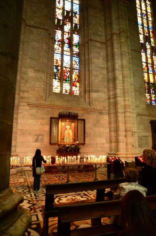 Lighting candles for Madonna con bambino