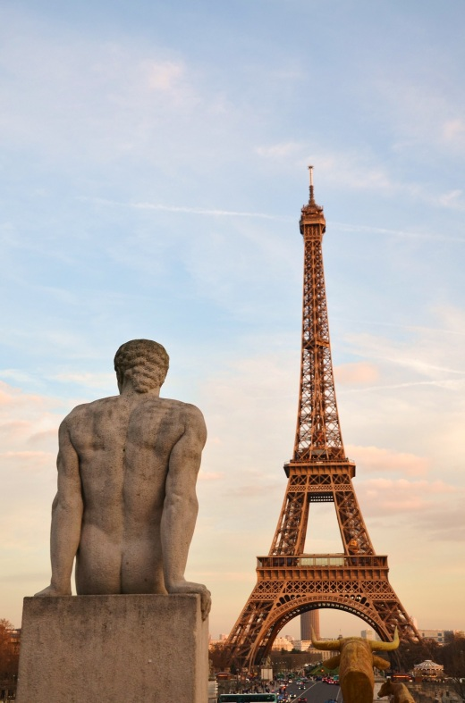 This statue, like the rest of us, seems to wait for the Eiffel Tower lights