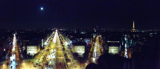 The full moon over The Champs-Elysees from on top the Arc de Triomphe