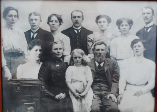 My grandfather Hans Kristian and his 9 siblings and parents.  He is second from the left in the back row