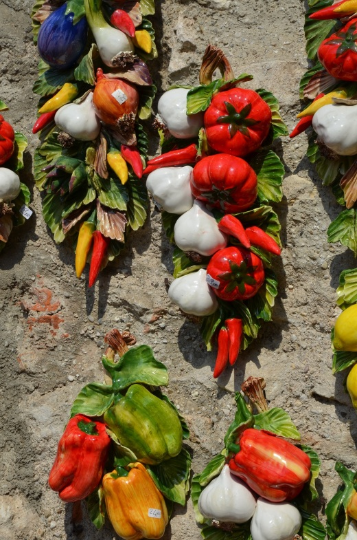 Ceramic vegetables on display on a shop wall
