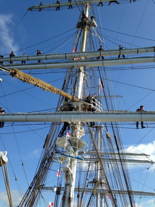 Kids singing shanties in the rigging as we came into port