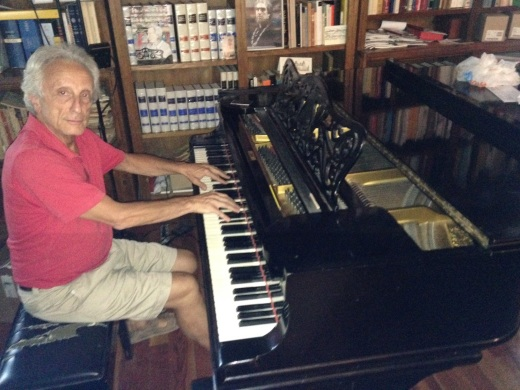 Andrea Passigli playing one of his pianos in his studio