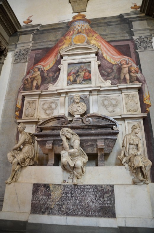 Michelangelo's tomb. The sculpture on the left representing painting, the center is sculpture, the right figure represents architecture, the painting above is The Pieta, and the center sculpture is a bust of Michelangelo.