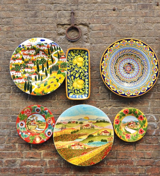 Ceramic plates for sale on the wall of a building in Siena