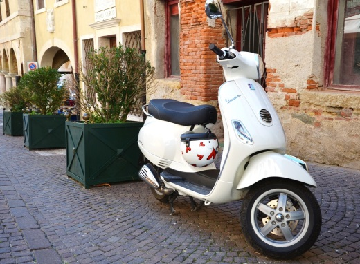 A solo Vespa left in Asolo after the departure of the motorcyclists