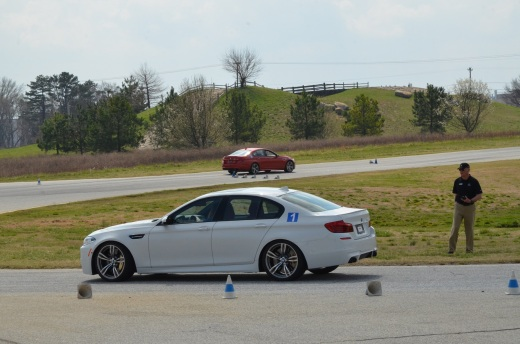 Instructor Steve watches Kim in the M5