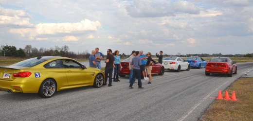 The entire group waits in the pit area as each participant ran the Big Track in the M3