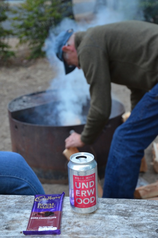 Wine in a can and chocolate by the campfire. Wine in a can travels much better in a motorcycle panier than a bottle