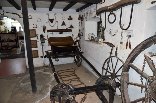 The basement was filled with horse buggies and gear