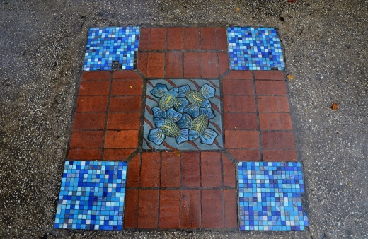 Very cool tiles inlaid into the side walk.
